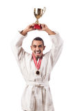 The funny karate fighter with cup on white. Funny karate fighter with cup on white royalty free stock images