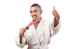 The funny karate fighter with cup on white Stock Image