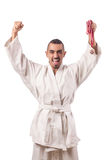 The funny karate fighter with cup on white Royalty Free Stock Photo