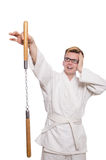 Funny karate fighter with nunchucks Stock Photos