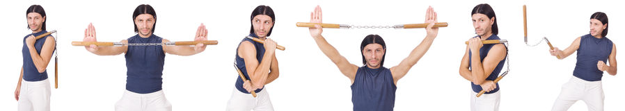 The funny karate fighter with nunchucks on white Stock Photo
