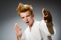 Funny karate fighter wearing Royalty Free Stock Photography
