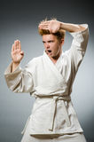 Funny karate fighter wearing Royalty Free Stock Photo