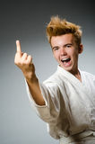 Funny karate fighter wearing Royalty Free Stock Photos
