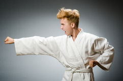 Funny karate fighter wearing Stock Photography
