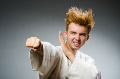 Funny karate fighter wearing Stock Photos