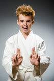Funny karate fighter wearing Royalty Free Stock Images