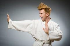 Funny karate fighter wearing. White kimono Royalty Free Stock Photos