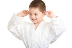 Funny karate kid touching ears Stock Photography