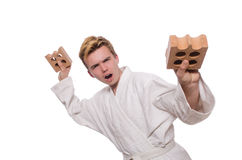 Funny karate man breaking bricks Stock Images