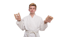 Funny karate man breaking bricks Royalty Free Stock Image