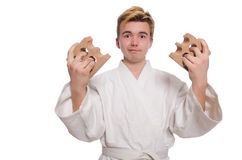 Funny karate man breaking bricks Stock Photos