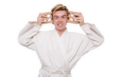 Funny karate man breaking bricks isolated Stock Image