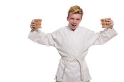 Funny karate man breaking bricks isolated Royalty Free Stock Images