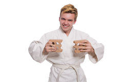 Funny karate man breaking bricks Royalty Free Stock Photos