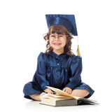 Funny kid in academician clothes with book Stock Photography