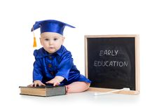Funny kid in academician clothes at chalkboard Stock Photo