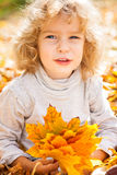 Funny kid in autumn Royalty Free Stock Image