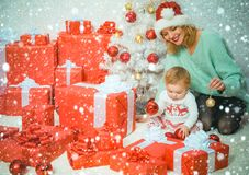 Funny Kid Baby With Mom And Christmas Gift Christmas Kids Child With A Christmas Present Gift Cute Little Kids Stock Image Image Of Young Xmas 166138013