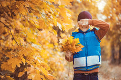 Funny kid on a background of autumn trees Stock Photo