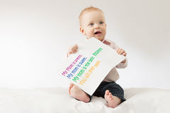 Funny kid with the big postcard. Mothers day greetings. Poster with sign Royalty Free Stock Photos