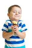 Funny kid boy eating ice cream isolated Stock Image
