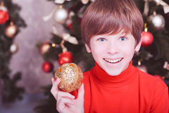 Funny kid boy holding christmas ball Royalty Free Stock Photos