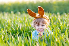 Funny kid boy of 3 years with Easter bunny ears, celebrating Eas Royalty Free Stock Photography