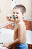 Funny kid brushing teeth Stock Image