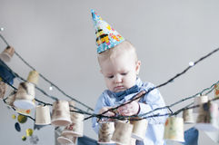 Funny kid in a celebratory cap Royalty Free Stock Photos