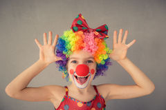 Funny kid clown playing indoor Royalty Free Stock Photography