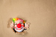 Funny kid clown playing indoor royalty free stock image