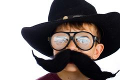 Funny kid in a cowboy costume. Royalty Free Stock Photography