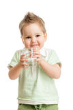 Funny kid drinking water from glass Stock Photography