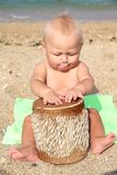 Funny kid Drumming on the beach Royalty Free Stock Photos
