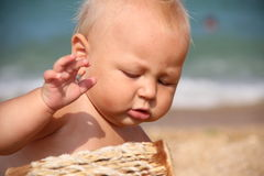 Funny kid Drumming on the beach Royalty Free Stock Image