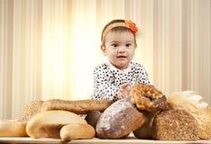 Funny kid eating bread Royalty Free Stock Photos
