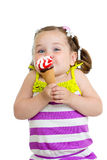 Funny kid eating ice cream isolated stock photography