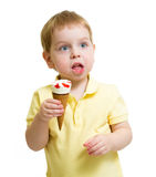 Funny kid eating ice cream isolated Royalty Free Stock Images