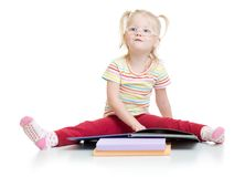Funny kid in eyeglases reading book isolated on Stock Image