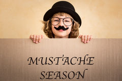 Funny kid with fake mustache Stock Image