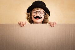 Funny kid with fake mustache. Holding banner blank royalty free stock image