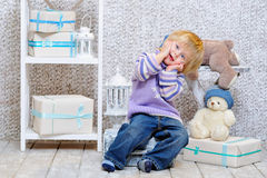 Funny kid and gift boxes Royalty Free Stock Image
