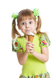 Funny kid girl eating ice cream isolated Stock Image