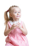 Funny kid girl with a glass of milk. Or yogurt isolated Royalty Free Stock Photos