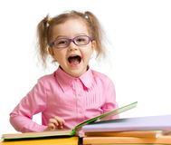 Funny kid girl in glasses with books speaking something isolated. On white royalty free stock photos