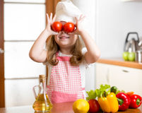 Funny kid girl preparing healthy food Royalty Free Stock Image