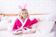 Funny kid girl in room. Smiling kid girl 4-5 year old wearing bunny headband in room. Easter season royalty free stock photos