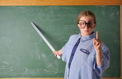 Funny kid girl at school teacher costume royalty free stock image