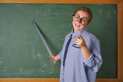 Funny kid girl at school teacher costume royalty free stock photography